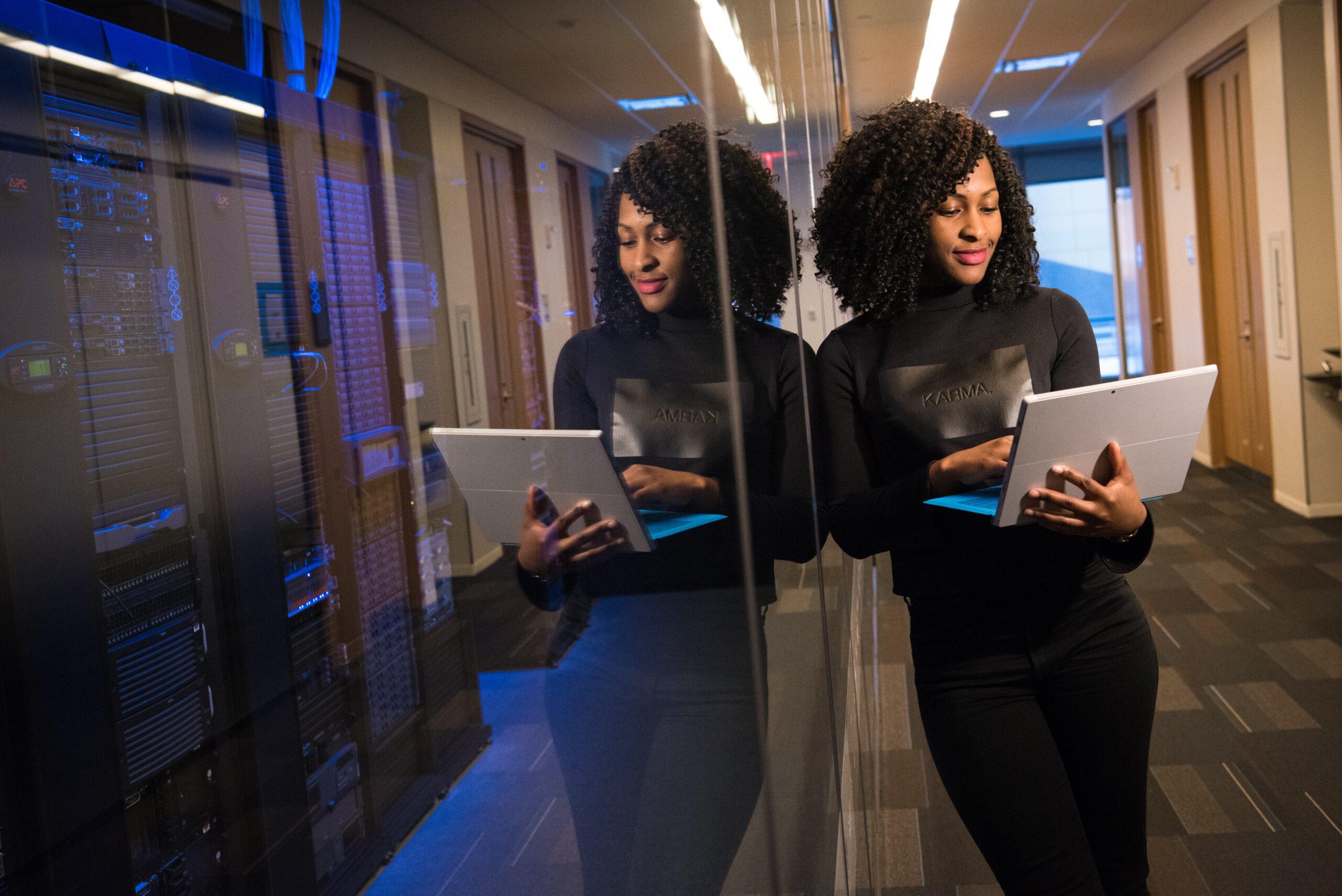 Female data analyst leaning against glass